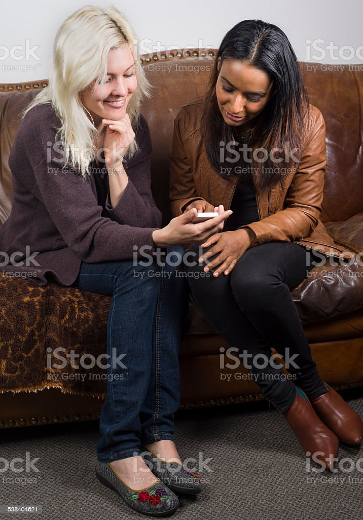 People waiting on a sofa