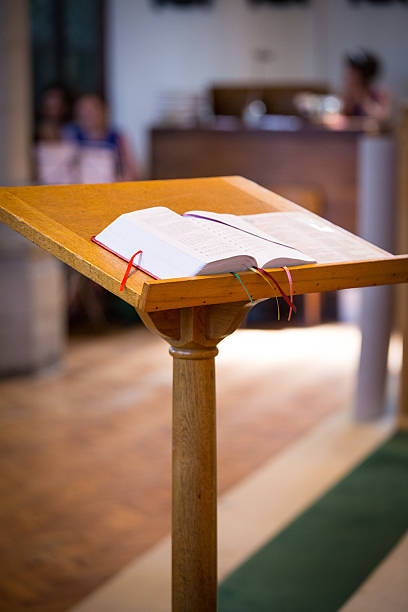 Reading Bible on the church pulpit. pulpit stock pictures, royalty-free photos & images