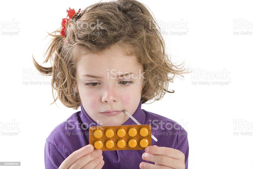 Reading pill's instructions royalty-free stock photo