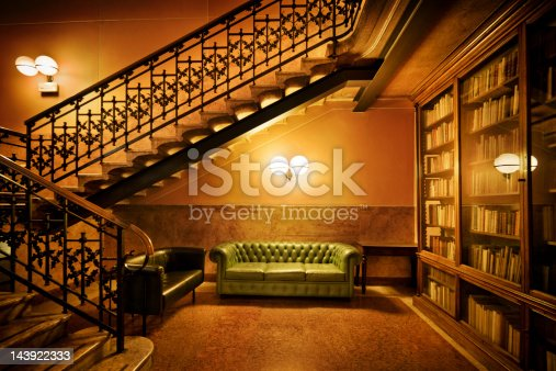 Reading Room with Sofa, Bookshelf and Staircase