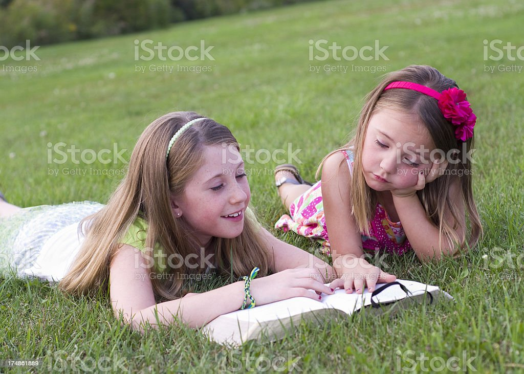 reading the bible together royalty-free stock photo