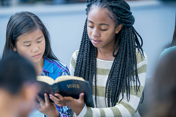 Reading the Bible Together stock photo