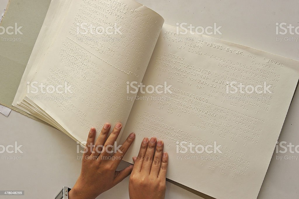 Reading the book Braille stock photo