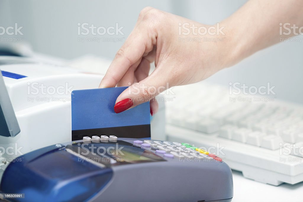 Reading the Credit Card. royalty-free stock photo