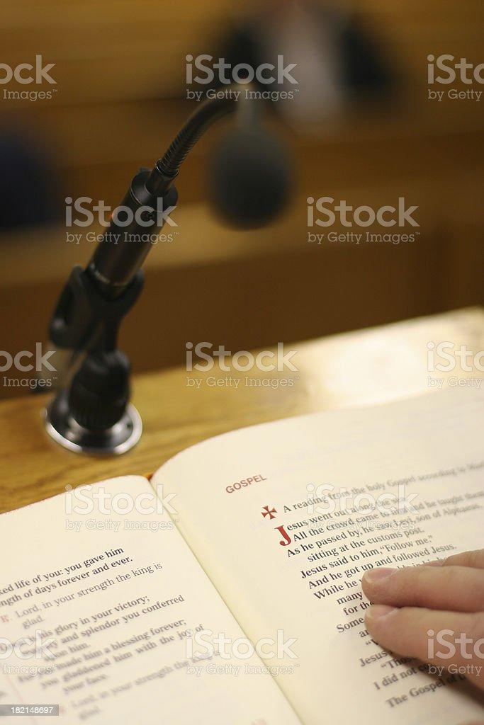 Reading the Gospel stock photo