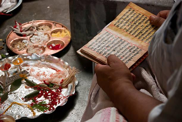 Reading the hindu scripts stock photo