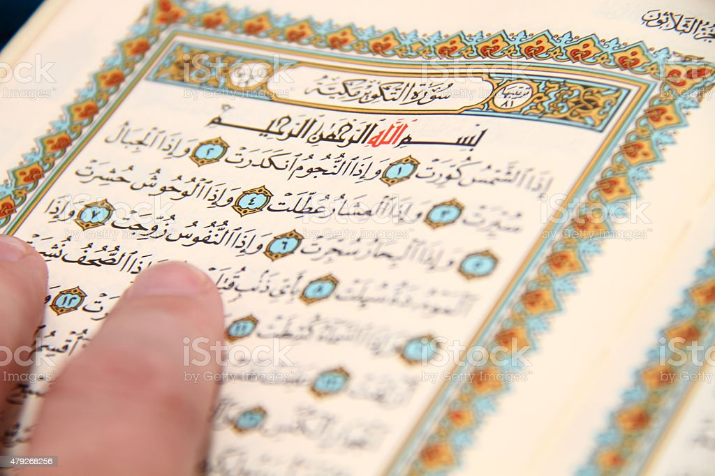 Reading The holy Quran stock photo