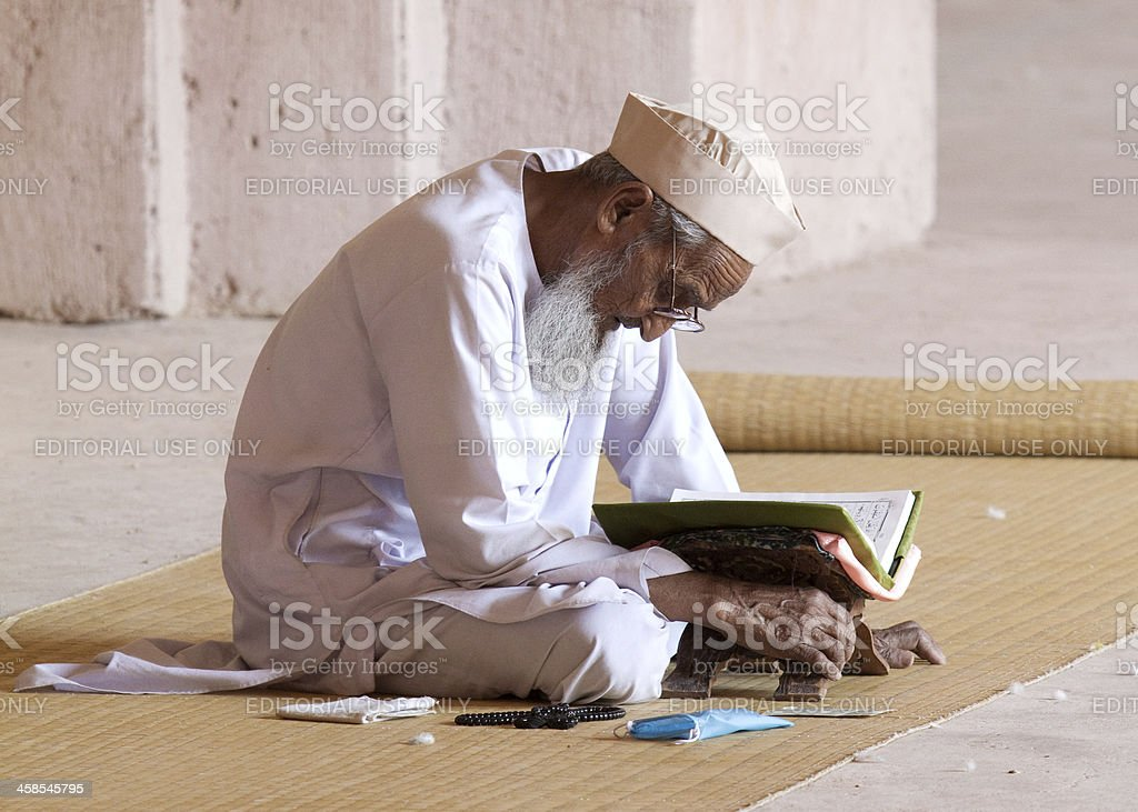 reading the Koran royalty-free stock photo