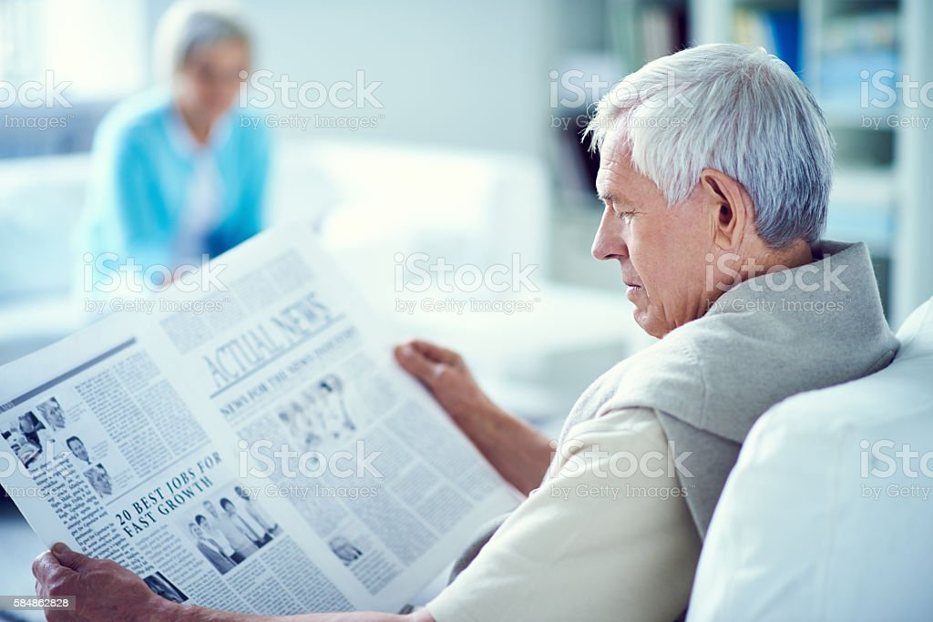 Reading the morning paper stock photo