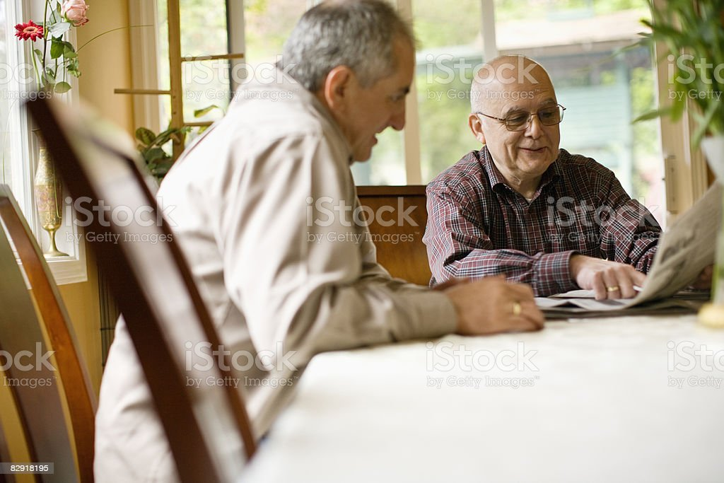 reading the morning paper royalty free stockfoto