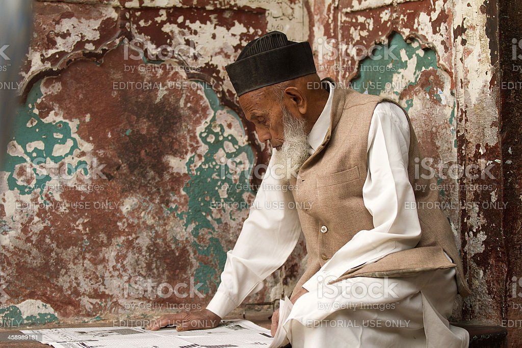 Reading the newspaper in New Delhi, India royalty-free stock photo