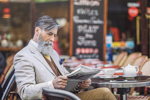Reading the newspaper stock photo