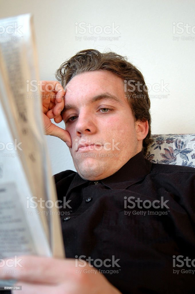 Reading the Newspaper royalty-free stock photo