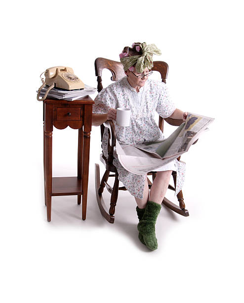 reading the paper. - crotchety stock pictures, royalty-free photos & images