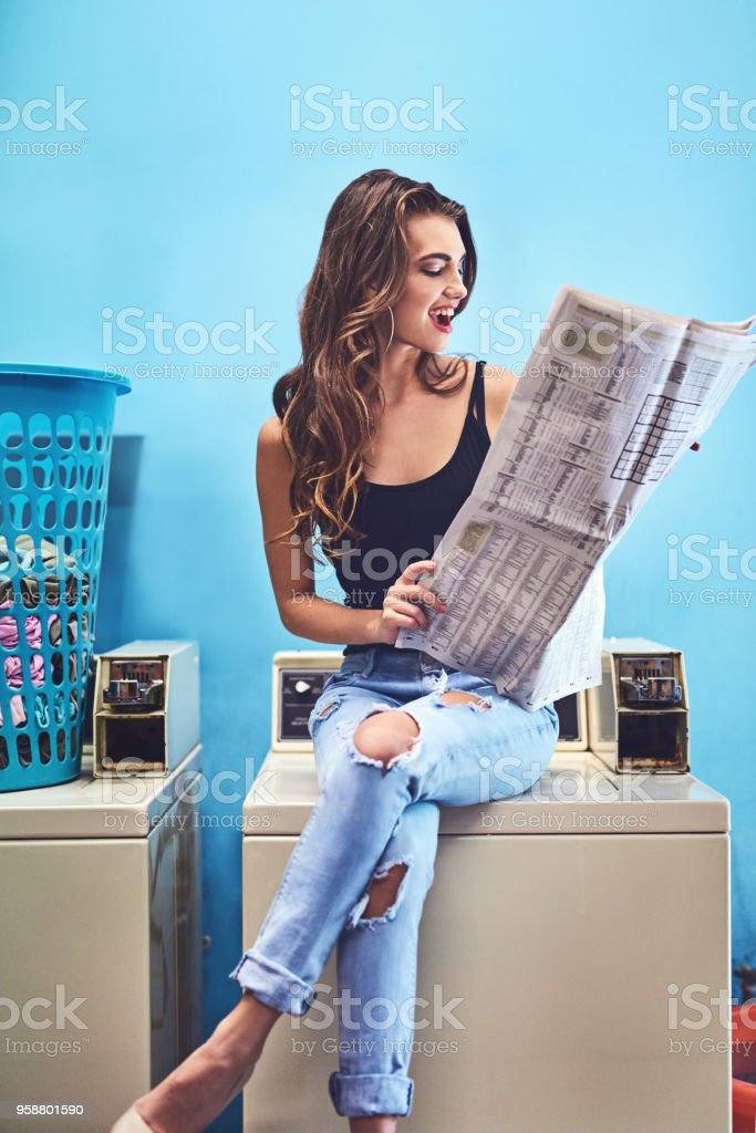 Reading the paper to make the time go quicker stock photo