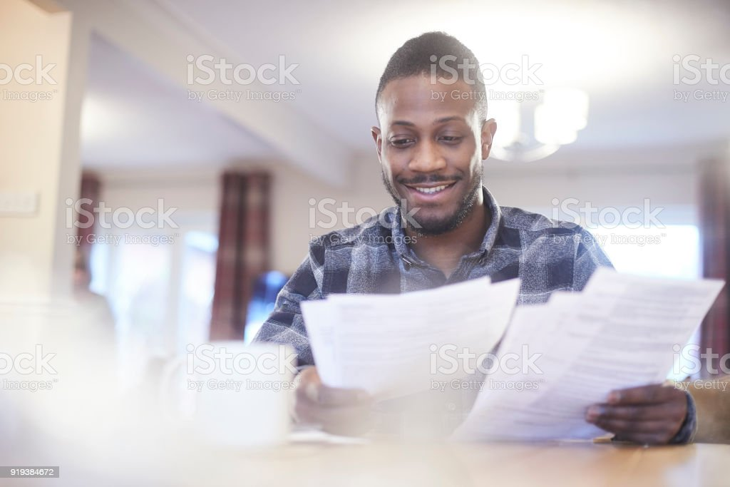 Reading through bank statements stock photo