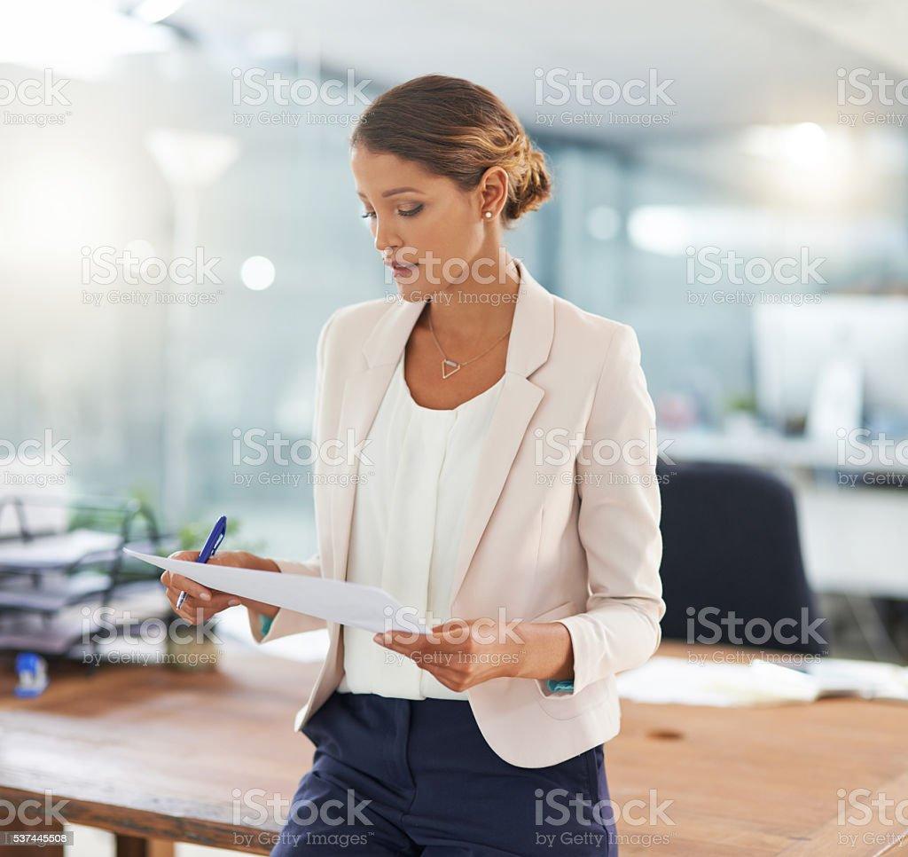 Reading through the contract stock photo