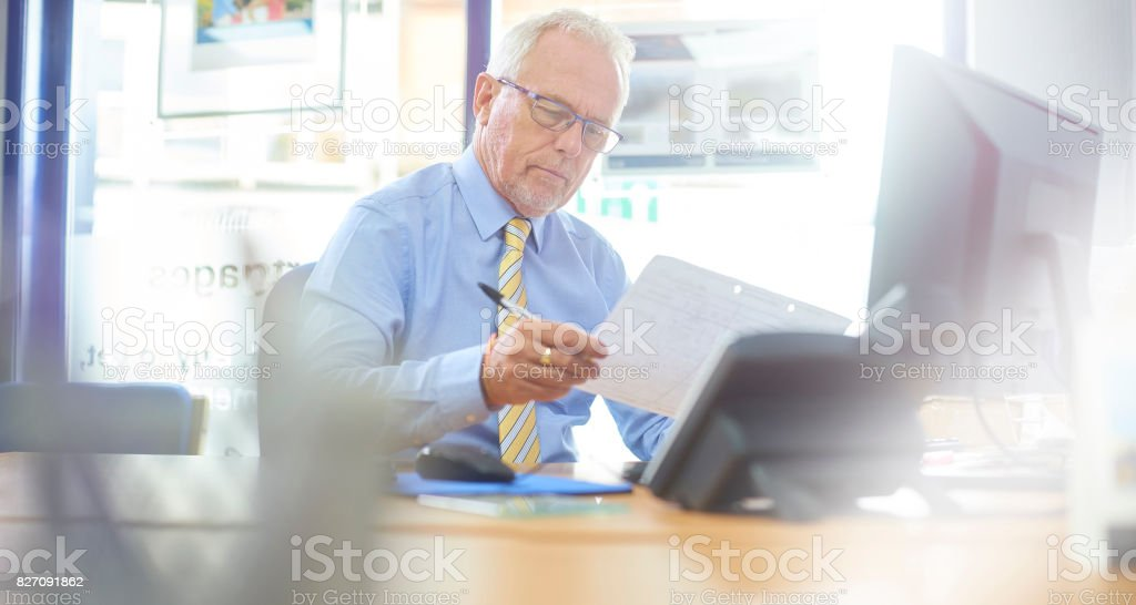 Reading through the monthly projections stock photo