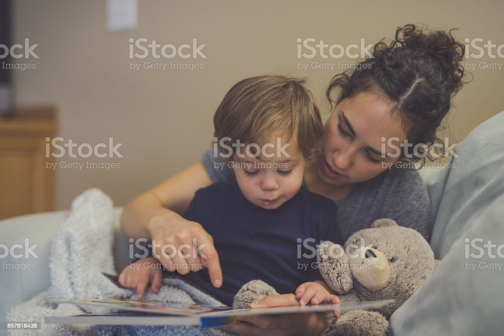 Reading time with Mom stock photo