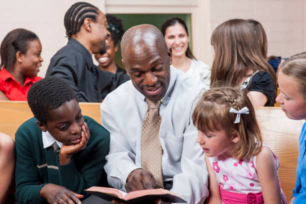 reading to kids - church stock photos and pictures