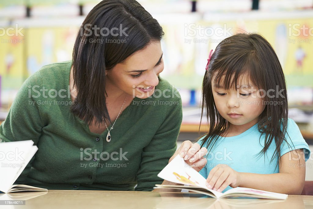 Reading to my Teacher in class stock photo