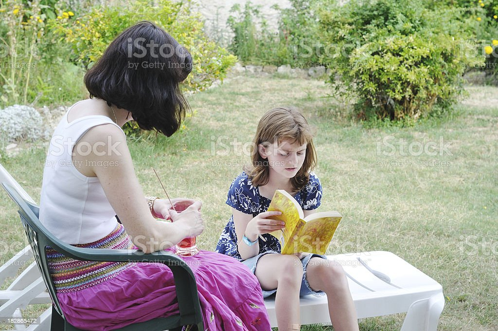 reading together in the garden stock photo