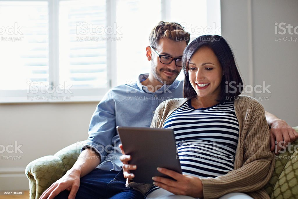 Reading up on soon to be parenting tips stock photo