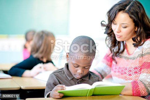 istock Reading with a Little Boy 505802112