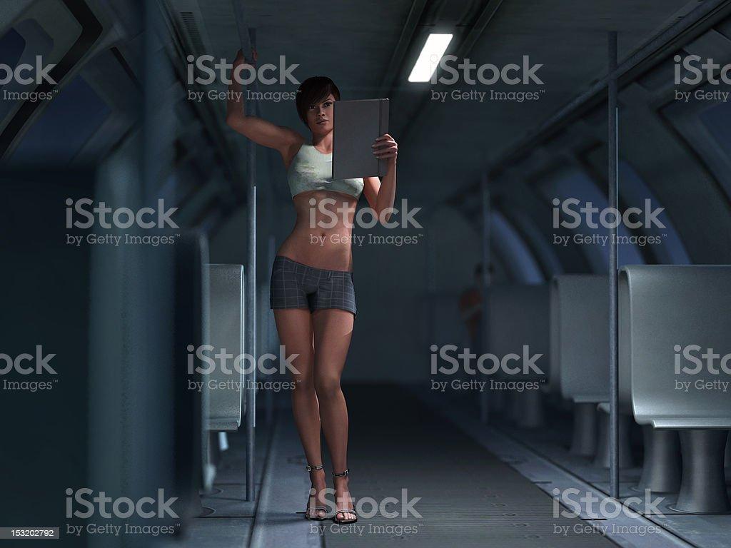 reading woman in subway car royalty-free stock photo