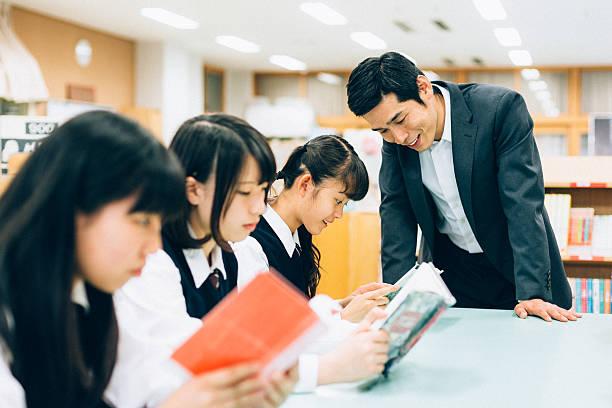 リーティング workshop の学校図書館 - 作文の授業 ストックフォトと画像