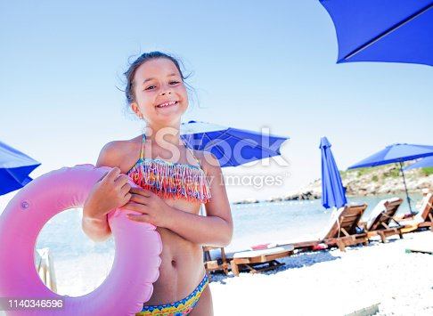 cute young girl at the beach