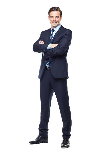 Ready for anything in the corporate world! A full length studio portrait of a handsome and young business executive isolated on white businesswear stock pictures, royalty-free photos & images