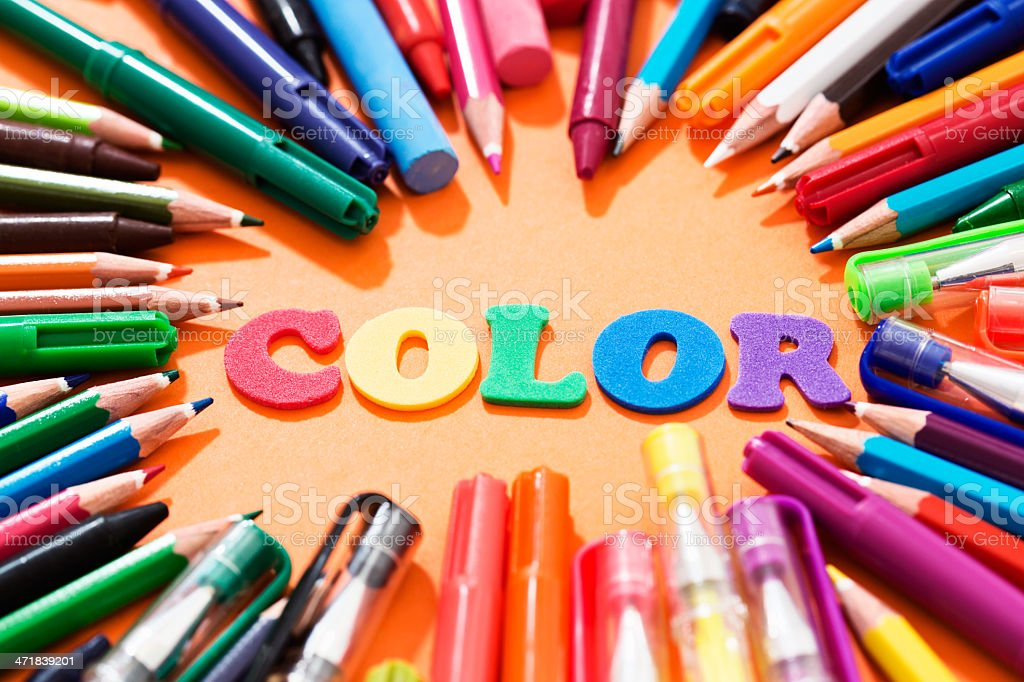 Ready for art class, drawing materials surround word COLOR royalty-free stock photo