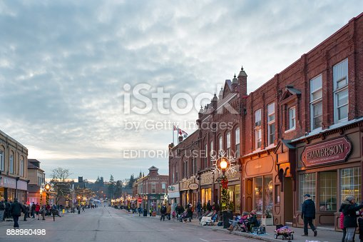 Port Perry, Ontario, Canada - December 2, 2017: Local residents gather at the the Victorian-era downtown area of small town Port Perry, waiting for the night time Christmas Parade.
