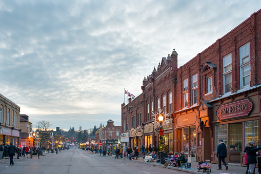 istock Ready for Christmas Parade - The lake side small town Port Perry at night in Christmas season 888960498
