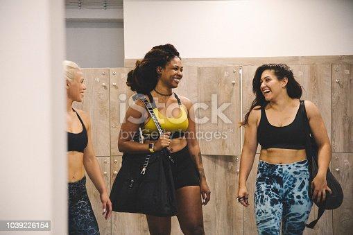 Women at locker room getting ready for training