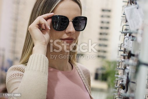 Ready for sun.  Woman in optical shop.