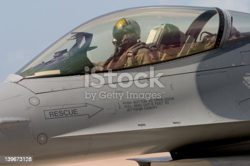 An F-16 pilot prepares to taxi out to the runway for take-off, at the 50th Anniversary Miramar Air Show, California.
