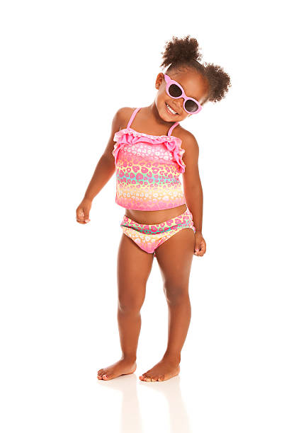 Ready for the Beach Adorable little girl in sunglasses and a bathing suit. Isolated on white. swimwear stock pictures, royalty-free photos & images