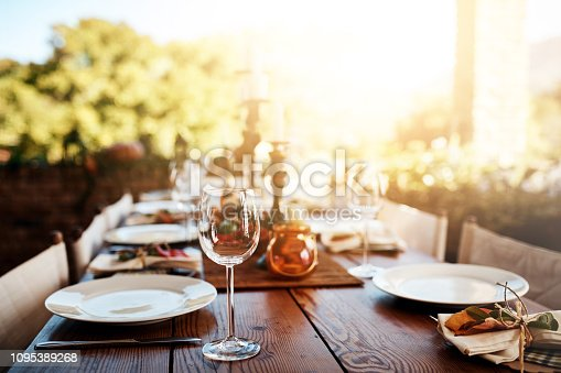 Cropped shot of a the layout of a Thanksgiving dining table outside