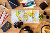 Travel accessories on a wooden desktop.