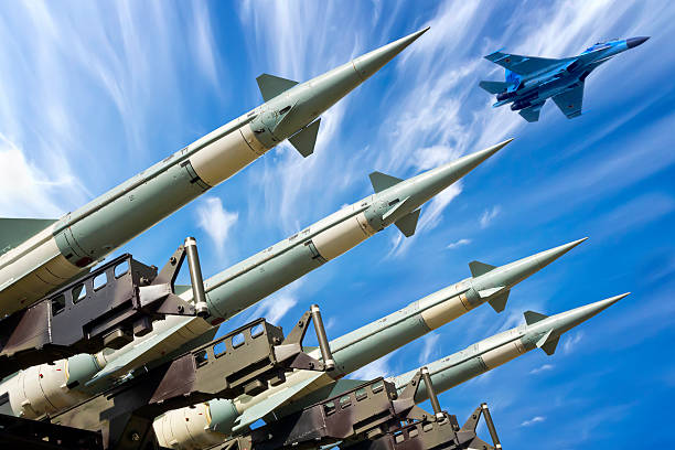 Ready for war Medium range self-propelled anti-aircraft missiles S-125 Neva ready to launch and fighter aircraft SU-27 in background antiaircraft stock pictures, royalty-free photos & images