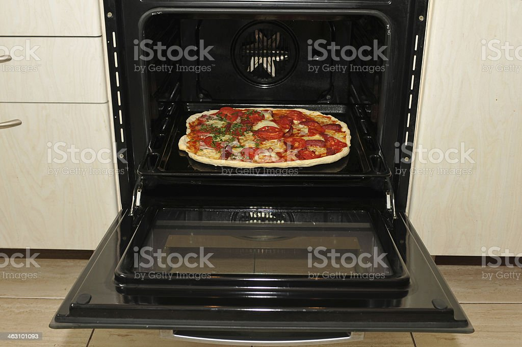 Ready pizza in oven stock photo
