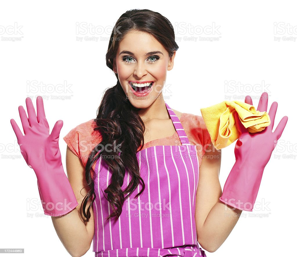 Ready to clean Portrait of an excited young woman wearing an apron and washing up gloves, holding a rag in hand and laughing at the camera. 20-24 Years Stock Photo