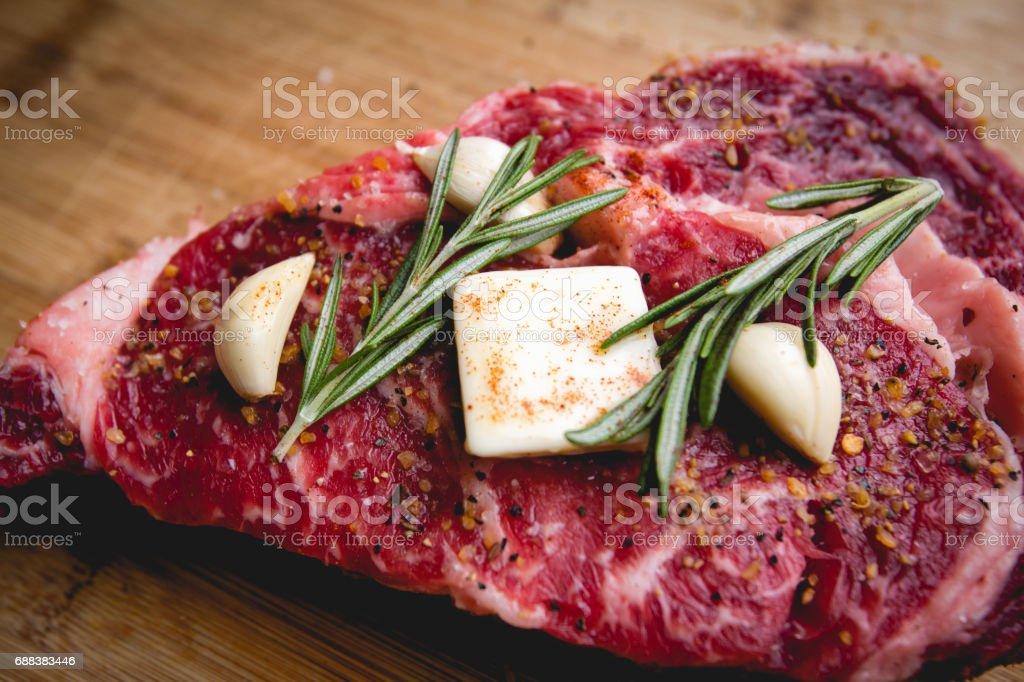 Ready to Cook Beef Ribeye Steak all Seasoned up stock photo