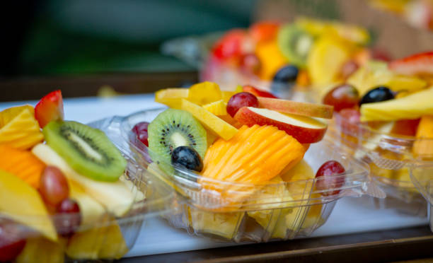 ready to eat fresh tropical food salad, hawaii, usa - crisp packet stock photos and pictures