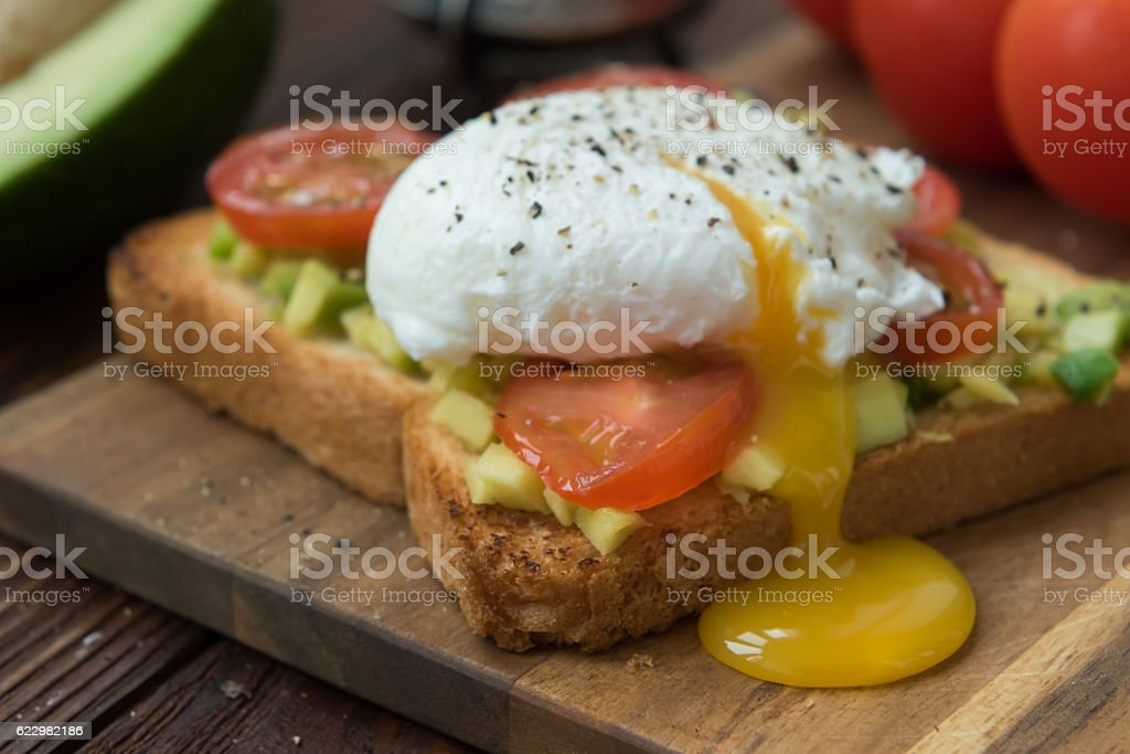 Ready to eat toast with poached egg and veggies stock photo