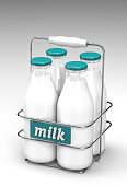 Four glass bottles of milk with light blue caps in a metal carrying case with holder and word milk written on the front on white background