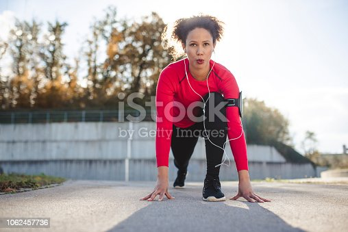 Woman in a starting position for a run