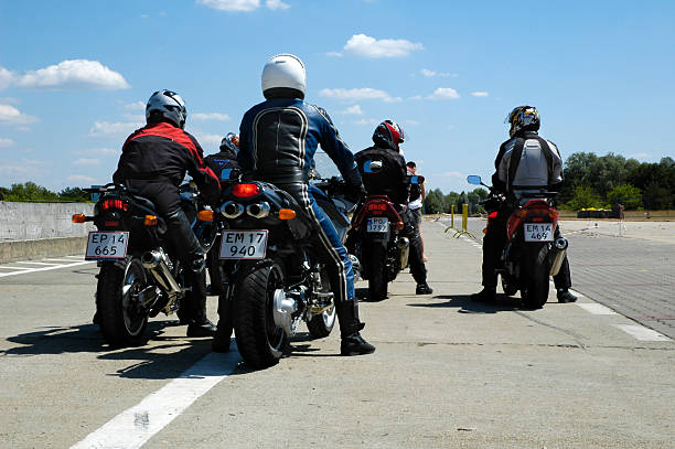 ready to go Poland, Poznan - July 04, 2005: Group of motorcyclists, preper for driving on the race track, during the course of improving driving skills with motorcycle. kawasaki heavy industries stock pictures, royalty-free photos & images